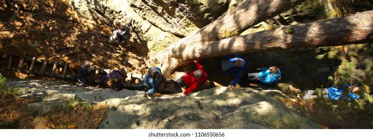 Group of peples walking through the ravine, Czech Republic, 10-11-2015