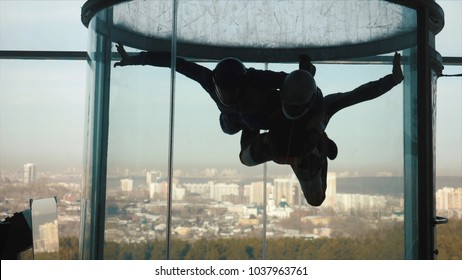 A group of persons trying the World's biggest free fall simulator, indoor skydiving Aero Gravity. Aerodynamic tube