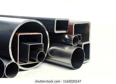 Group perspective tubes and metal profiles steel and iron quality products isolated white background material production for construct industry stock iron shine metal