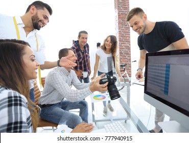 group photo of editors working in a modern office.