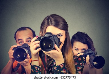 Group of photographers with professional cameras