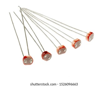 A group of photoresistors (or light-dependent resistor, LDR, or photo-conductive cell), isolated on white. They are light-controlled variable resistors.