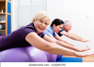 Group in physiotherapy using ball for gymnastics