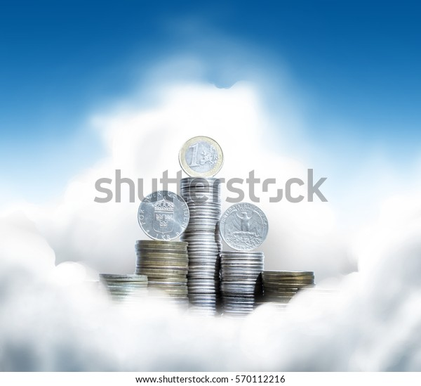 Group of piles of coins with quarter dollar, one euro and krona on top in sunny clouds