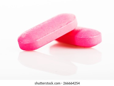 Group of pink medical pills isolated on white background