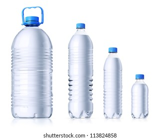 Group of plastic bottles (5l, 1.5l, 0.6l and 0.33l) with water without labels. Isolated on white.