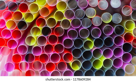 Group Of Plastic Straws For Drinks. Colorful Tubes. Abstract Background