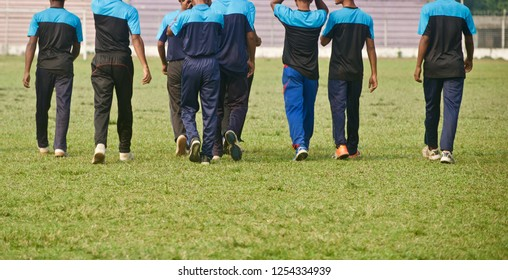 Group of players walking in a sports ground unique photo