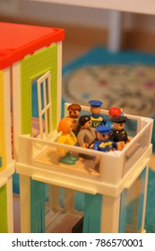Group of Playtive Junior toy people having a party on a balcony in soft focus on circa December 2017 in Poznan, Poland