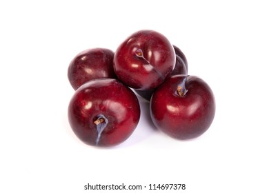 Group of plums  isolated on a white background