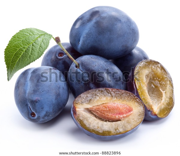 Group of plums with leaf isolated on a white background.