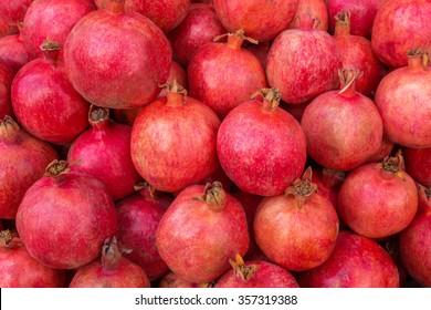 Group of pomegranates. Pomegranate closeup, background