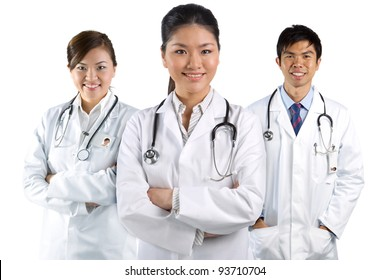 A group Portrait of an Asian medical team, isolated on white.