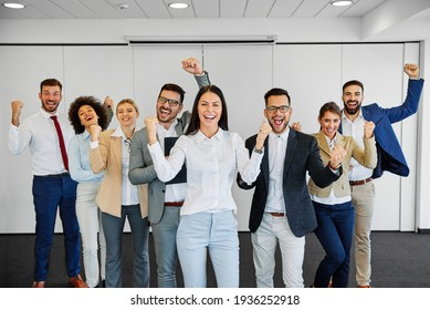 Group portrait of business team celebrating success  in the office