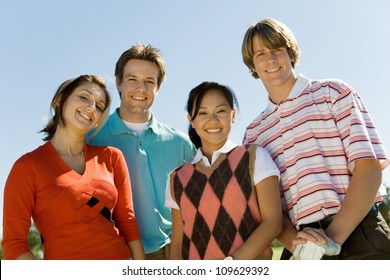 Group portrait of happy young friends smiling