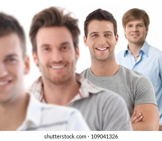 Group portrait of happy young men, looking at camera, smiling.