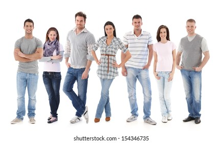 Group portrait of happy young people together, looking at camera, smiling.