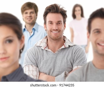 Group portrait of happy young people together, looking at camera, smiling.?