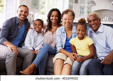 Group portrait of multi generation black family at home