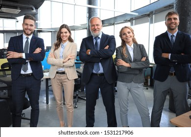 Group portrait of a professional business team looking confidently at camera.