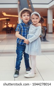 Group portrait of two white Caucasian cute adorable stylish children preschoolers hugging and holding their hands. Love friendship childhood concept. Best friends forever