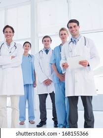 Group portrait of young doctors standing together at the hospital