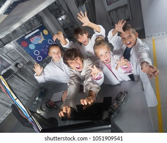 Group of positive children are concentrating on finding a way out of bunker quest room