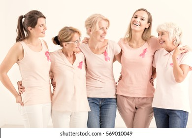 Group of positive women from anticancer foundation hugging together
