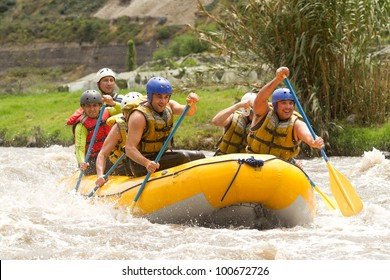 Group Of Power Young Man On A Rafting Boat Patate River Ecuador Shoot From Water Level