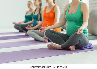 Group of pregnant woman doing yoga