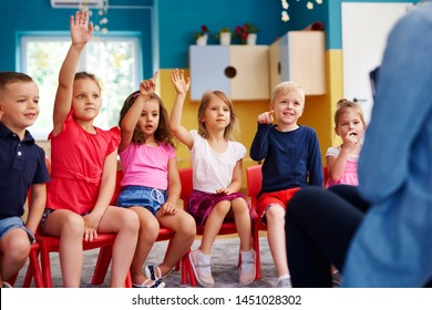 Group of preschool children answering a question