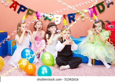 Group of preschool kids with the party horns