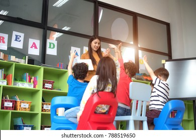 group of preschool kindergarten are in classroom, attention in the subject teaching by the teacher