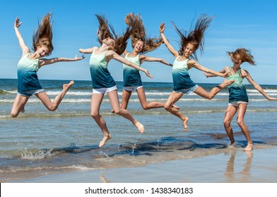 Group pretty girls jumping on the beach