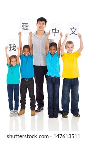 group of primary pupils learning chinese with teacher