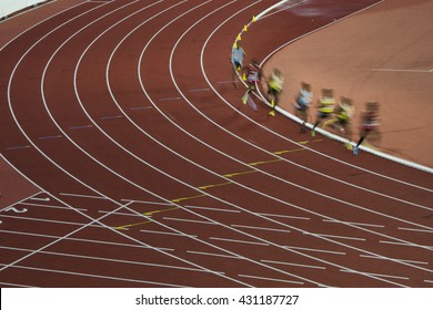 Group of professional athletes on the long distance track during athletic competition which is preparation on olympic game in Rio
