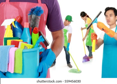 group of professional cleaning services and housewife ready to do the chores