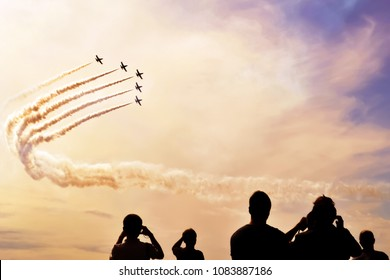 A group of professional pilots of military aircraft shows tricks in the evening sky, leaving beautiful traces of clouds. International Aviation and Space Salon, MAKS. Zhukovsky, Moscow Region, Russia.