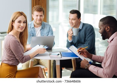 Group of professionals working together in office