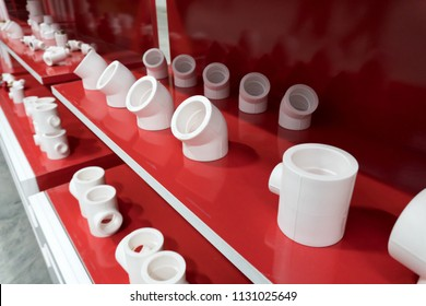 Group of PVC connection on shelf of a studio or store or exhibition stand. Different fittings.