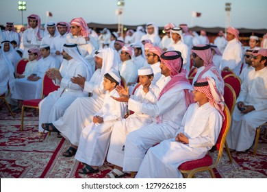 A group of Qataris are encouraging the winners of the falconry competition, Al-Burtha and Alzakherah Festival, North of Qatar, June 13, 2013