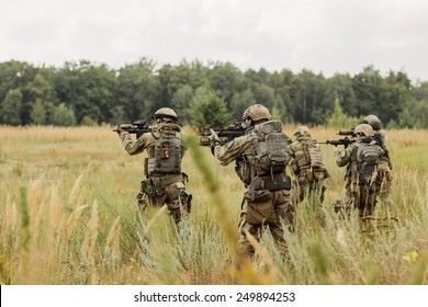 group of  rangers conducting an offensive against the enemy