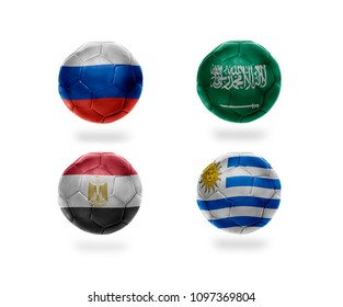 group A . realistic football balls with national flags of russia, saudi arabia, egypt, uruguay. soccer teams. 3D illustration