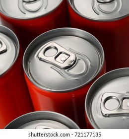 Group of red aluminum soda or cola cans top view