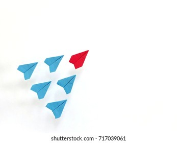 Group of red and blue paper plane on white background.