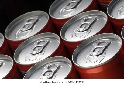 group of red can tins close up on a black background