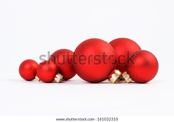 Group of red christmas balls on white background