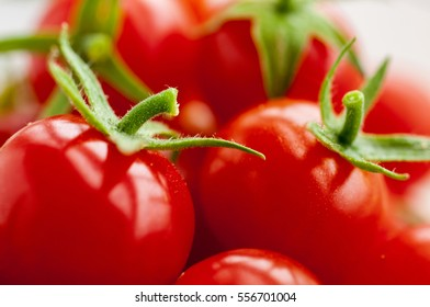 Group of red fresh tomatoes vegetables close up