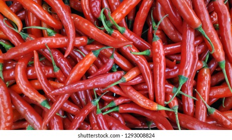 Group of red hot chilli peppers in market