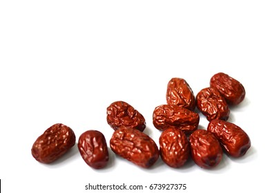 A Group of Red Jujube Isolated from White Background. Jujube is also called Chinese date and often used in traditional Chinese medicine.  Copy Space at Top.